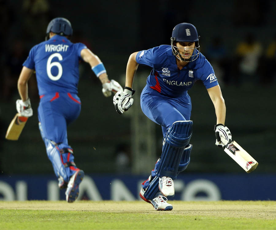 England's batsmen Alex Hales, right, and Luke Wright run between wickets