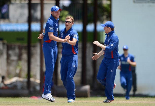 Danny Briggs of England celebrates with Stuart Broad after dismissing Mohammad Hafeez of Pakistan during the ICC T20 World Cup Warm Up Match