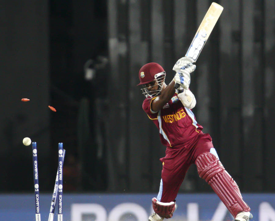 Denesh Ramdin of the West Indies gets bowled out