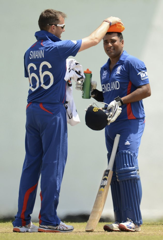 England's Samit Patel has an ice pack held on his head by Graeme Swann (L) during a warm-up match