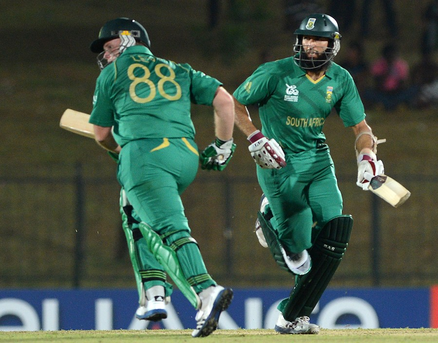 South African cricketers Richard Levi (L) and Hashim Amla (R) run between the wickets