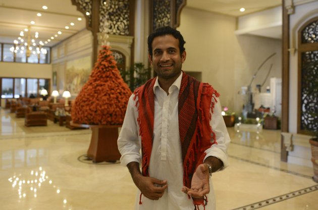 Indian cricketer Irfan Pathan gestures in a hotel lobby