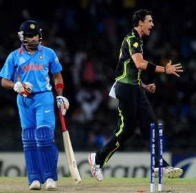 Mitchell Starc celebrates at knocking out Rohit Sharma's off stump