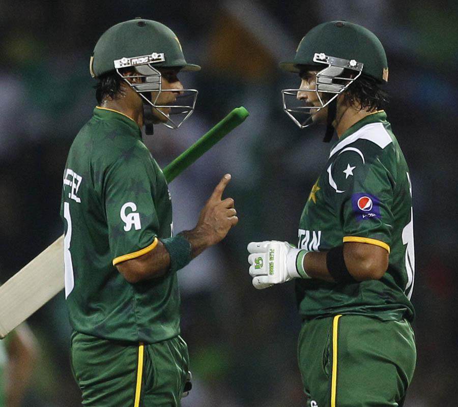 Pakistan's captain Mohammad Hafeez, left, talks to fellow batsman Imran Nazir