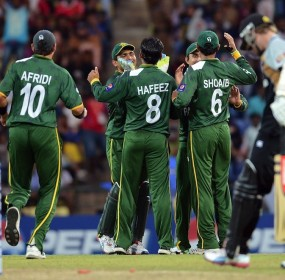 Pakistan cricketers celebrate the run out of New Zealand batsman Kane Williamson