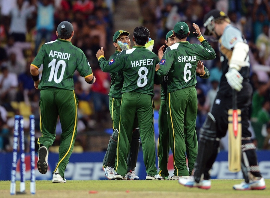 Pakistan cricketers celebrate the run out of New Zealand batsman Kane Williamson