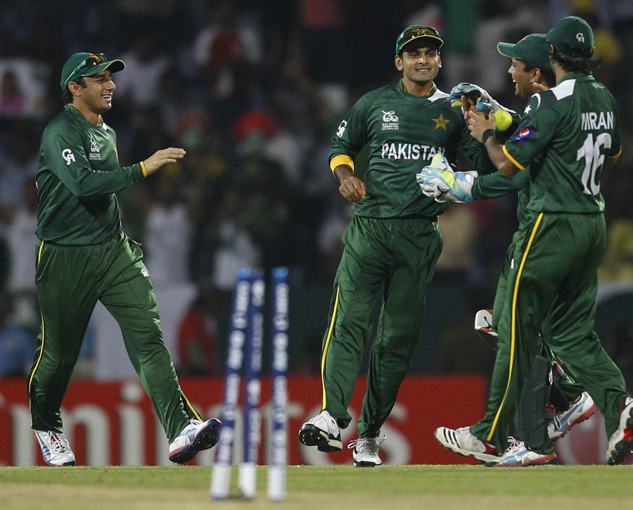 Mohammad Hafeez, second left, celebrates the run-out of Bangladesh batsman Tamim Iqbal