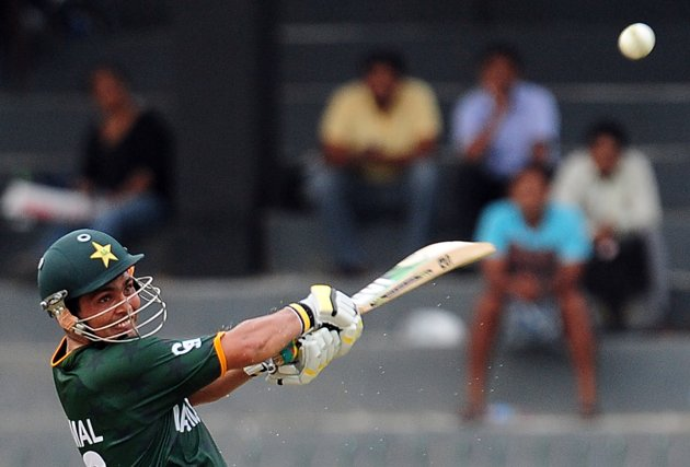 Pakistan cricketer Kamran Akmal plays a shot during a World Twenty20 warm-up match