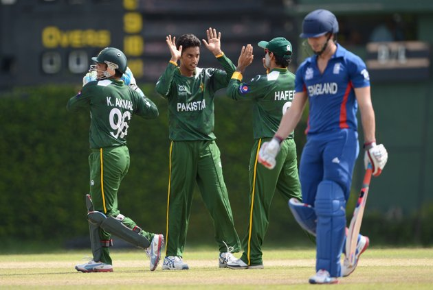 Raza Hasan of Pakistan celebrates with teammates after dismissing Craig Kieswetter of England