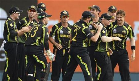 Australia's Watson is congratulated by teammates after dismissing Ireland's Porterfield during the World Twenty20 group B match at the R. Premadasa Stadium, Colombo
