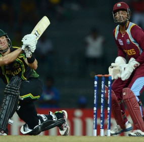 Shane Watson of Australia hits out for six runs