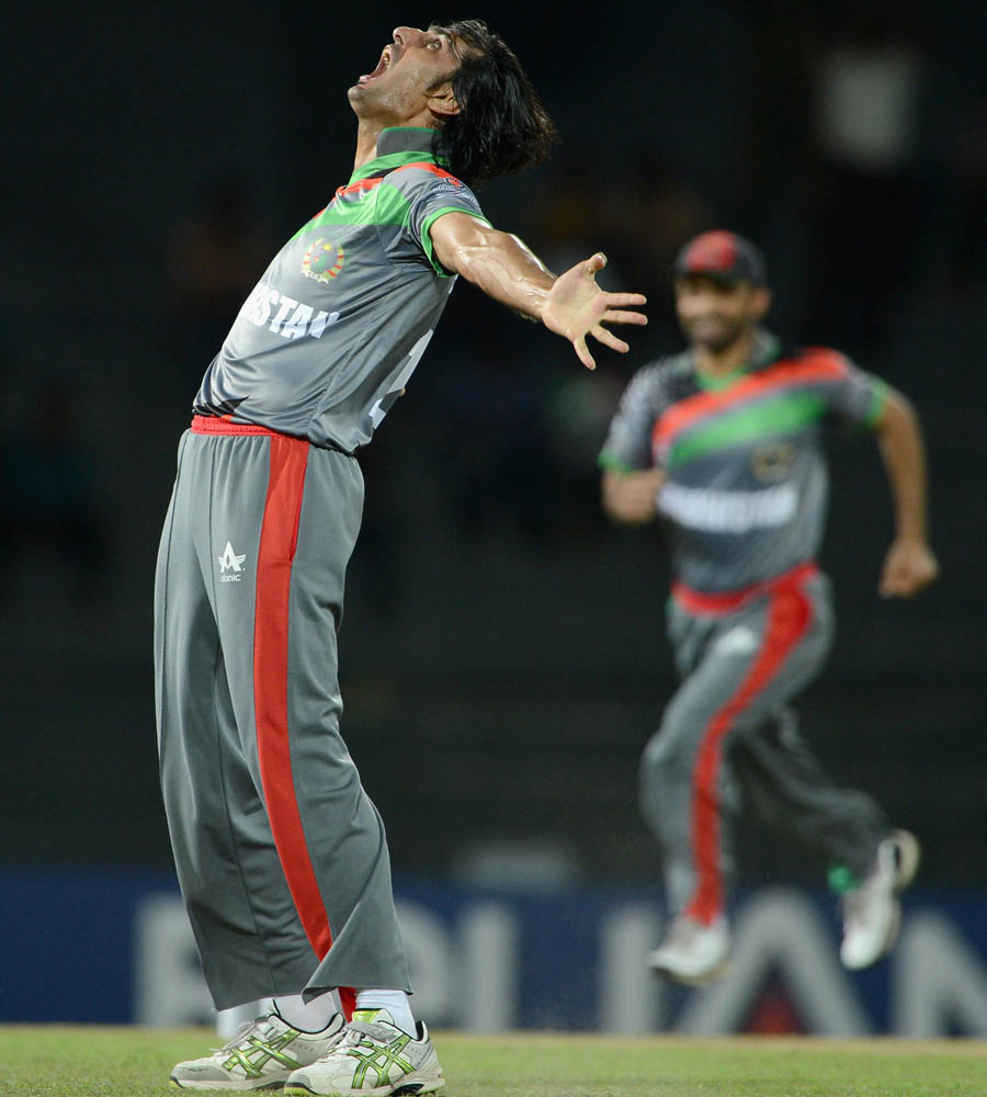Shapoor Zadran of Afghanistan celebrates dismissing Craig Kieswetter of England