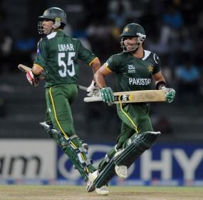 Umar Gul and Umar Akmal cross for a run, Pakistan v South Africa