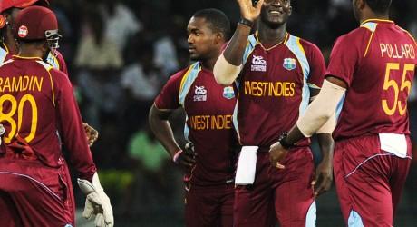 West Indies cricketer Darren Sammy (2R) celebrates after he dismissed Ireland cricketer Paul Stirling