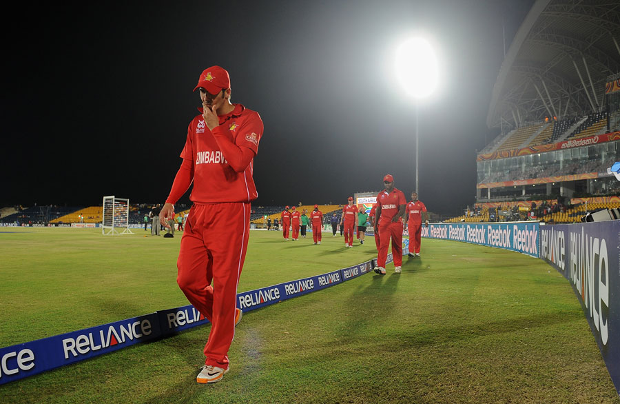 Zimbabwe leave the field after their second heavy defeat, South Africa v Zimbabwe