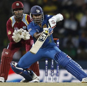 Mahela Jayawardene, right, plays a shot