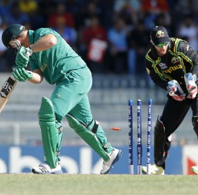 South Africa's batsman Richard Levi, left, is bowled out by Australia's bowler Xavier Doherty