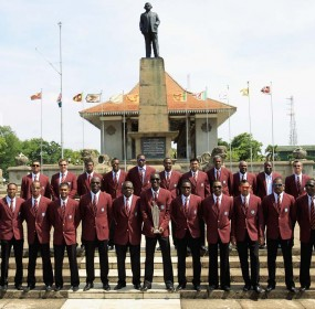 The West Indies Cricket Team pose for a photograph with the ICC World T20 Trophy at Independence Square